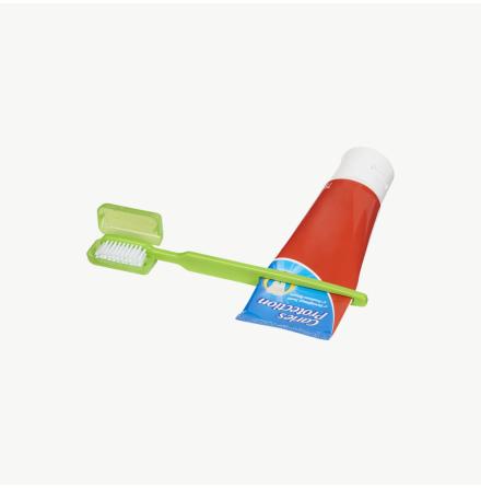 Tandborste och tubklämma